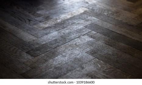 wooden parquet floor illuminated by outdoor light