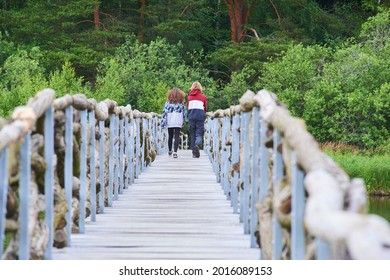 A wooden path around the beautiful pond Olsina. The Olsina pond near Horni Plana is one of the highest altitude ponds in Cezc republic