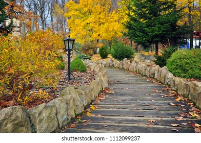 Wooden path in autumn park nature