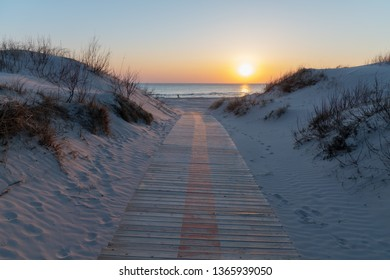 Wooden path to Baltic sea in dunes.
