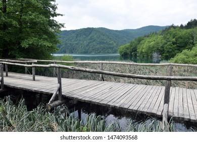 Wooden path between beautiful lakes in Plitvice Lakes National Park (Nacionalni park Plitvicka jezera). Karlovac County, Croatia.