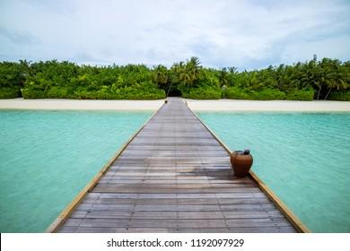 Wooden path, boardwalk to tropical beach in Maldives island