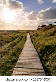 Wooden path heading along the coastline of the island Amrum Germany.