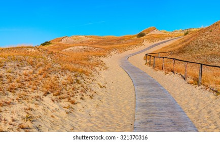 Wooden path into the Grey Dunes. Curonian Spit, Lithuania.