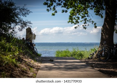a wooden path leads to the beach of the Baltic Sea