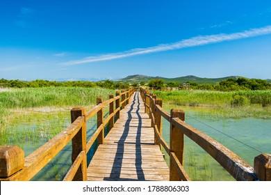 Wooden path in nature park Vrana lake (Vransko jezero), Dalmatia, Croatia, beautiful tourist destination - Shutterstock ID 1788806303
