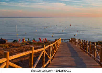 Wooden path on the beach in sunset time. Mijas Costa. Andalusia. Spain