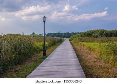 Wooden path to Orthodox skete - monastic community in Odrynki, small village in Podlasie region of Poland