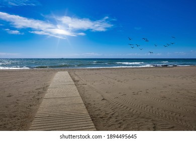 Wooden path in the sand of a bach in Malaga (Spain)