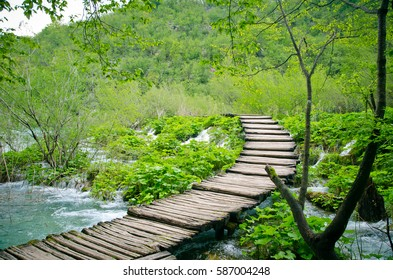 Wooden path and waterfall in Plitvice National Park, Croatia. Flooding in the spring