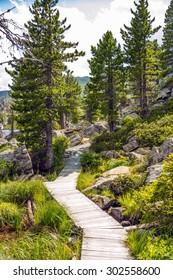 Wooden pathway around lake Windebensee in Carinthia, Nockalmstrasse, Austria