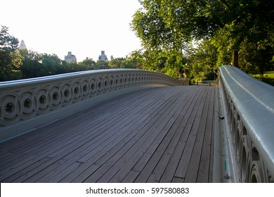 Wooden pathway of Bow bridge in the morning at Central Park