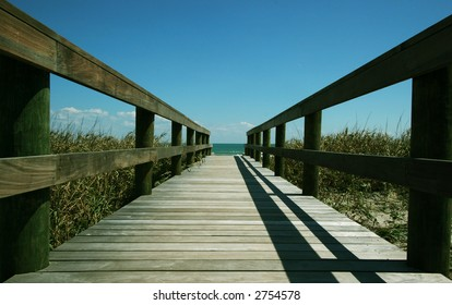 Wooden pathway leading down to a beautiful beach