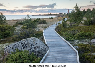 The wooden pathway leading over beautiful but fragile bare sand dunes and lichen covered coastal habitats on the small Mohni island in Finnish Gulf, belonging to the Lahemaa national park, Estonia