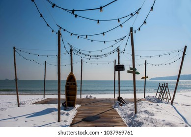 Wooden patio on snowy beach
