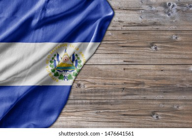 Wooden pattern old nature table board with El Salvador flag
