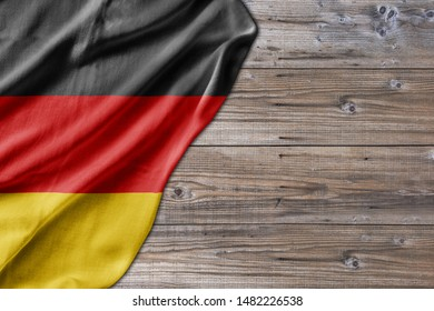 Wooden pattern old nature table board with Germany flag