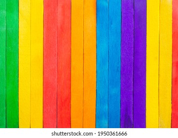Wooden pattern wallpaper texture background. flat lay or top view with copy space. mulitcolor green, yellow, red, orange,blue wooden.