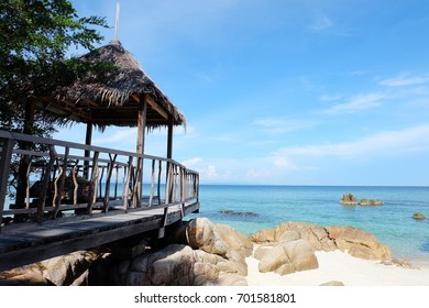 Wooden pavillion on the white sand beach and nice blue sky. Relax place for summer.
