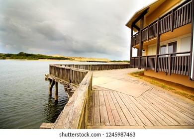 Wooden pavillion surrounded by large woodent jetty at the lake in Souston, France