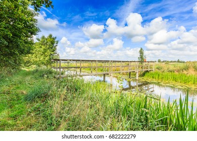 Wooden pedestrian bridge in nature reserve Willeskop at town of Oudewater in the Dutch province of Utrecht (province)