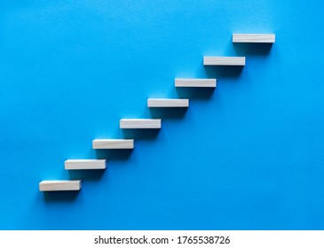 Wooden pegs forming a stairway. Wooden stairs elevate promotion of the business. Business promotion stairs to heaven. stairs to the blue sky. Wooden stairs. Business start up. Promotion and elevation.
