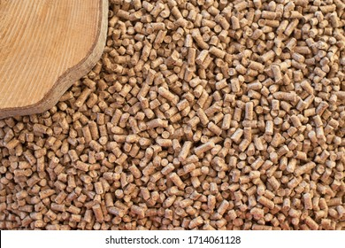 Wooden pellets background, pattern. Close up natural pellet and wooden cut. Ecological heating, renewable energy Biofuels. Top view. Flat lay ecological fuel for solid fuel boilers.