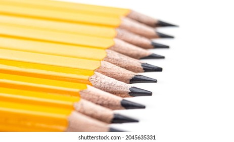 Wooden Pencils in a Row on a White Background with Copy Space. Education and Business Concept. Working Together. Selective Focus on Sharp Edges of Pencils. Teamwork Composition