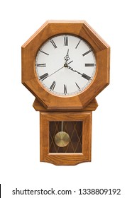 Wooden pendulum clock isolated on white.
