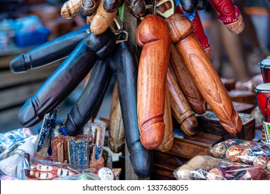 Wooden penises figures souvenir on display for sale to tourists on street local market in Ubud, island Bali, Indonesia. Wooden penises are used in Bali as a remedy against the evil eye and bad spirits