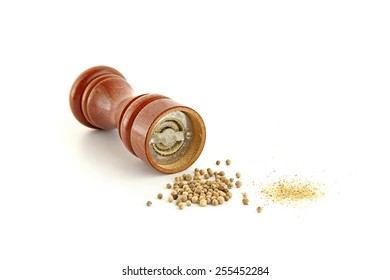 Wooden pepper mill, white pepper and pepper powder on white background.