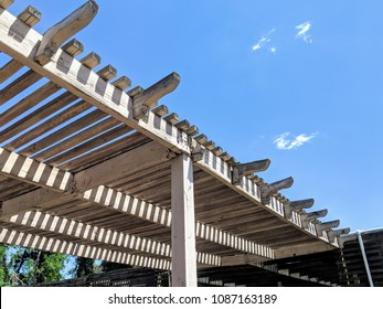 wooden pergola and blue sky
