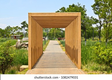 Wooden pergola tunnel in a park