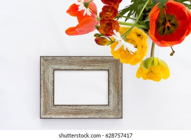 wooden photo frame mock-up with summer flowers