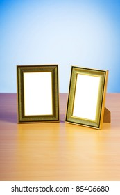 Wooden picture frames on the gradient background