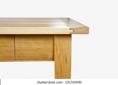 wooden piece of furniture - Edge of a table in front of white blackground