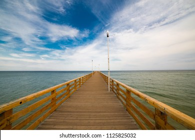 Wooden pier to the Baltic Sea. Kaliningrad region, Russia