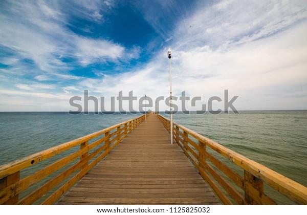 Wooden pier to the Baltic Sea. Kaliningrad region, Russia