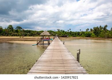 Wooden Pier beach with cloudy sky at Ao Tan beach, Koh Mak island, Trat, Thailand