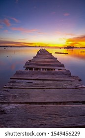 Wooden pier with beautiful light sunset view. This photo take in the one of beautiful beach Batam Island Indonesia.