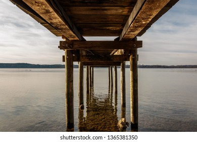 Wooden pier from below at Ammersee in Bavaria, Germany