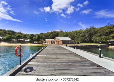 Wooden pier and brick buildings of Sydney's QUarantine station which is a historic museum of colonisation of Australia