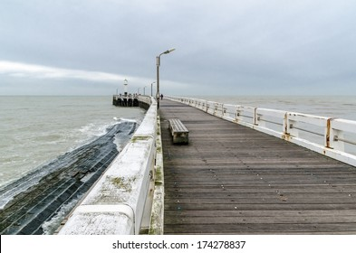 Wooden pier at the entrance of North Sea port in Nieuwpoort, Belgium