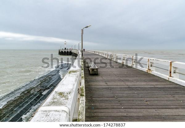 Wooden pier at the entrance of North Sea port in Nieuwpoort, Belgium