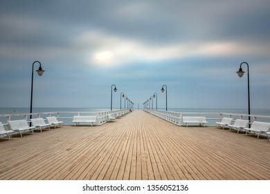 Wooden pier in Gdynia Orlowo at dawn, Poland