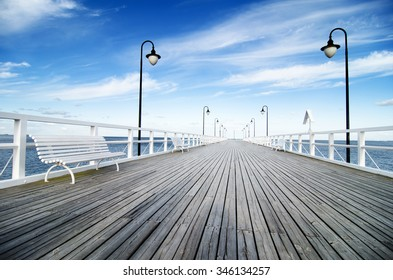 Wooden pier in Gdynia - Orlowo, Poland. wooden pier with blue sky.