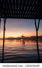 Wooden Pier and Island Sunset With Tour Boat - Siargao, Philippines