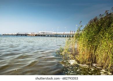 Wooden pier in Jurata town on coast of Baltic Sea, Hel peninsula, Poland
