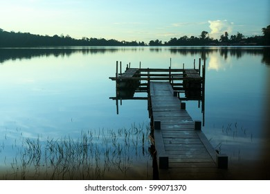 Wooden pier at the lake in Bali in the morning, Indonesia