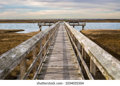 A wooden pier in Long Island, New York at Sunset.